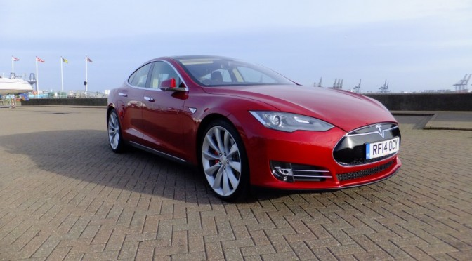 Tesla Model S P85+  The future is bright red, the future is pure electric and accelerates from 0 to 60 in 4.2 seconds!!