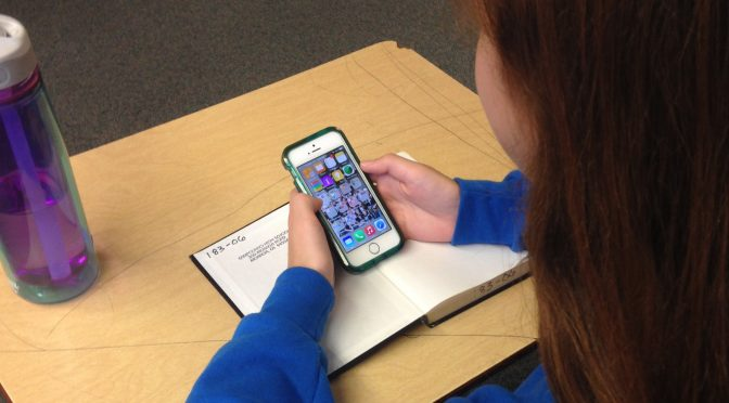 Using mobile device in class - image credit Intel Free Press